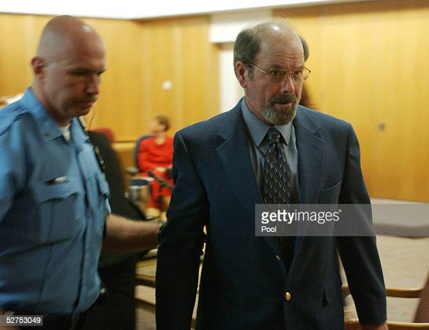 Dennis L Rader suspected of being the BTK serial killer is escorted from the Sedgwick County courtroom after his arraignment May 3 2005 in Wichita...