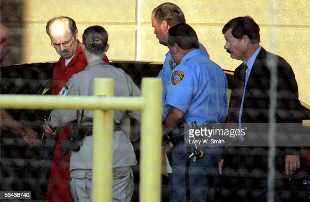 Dennis L Rader the man admitting to be the BTK serial killer is escorted into the El Dorado Correctional Facility on August 19 2005 in El Dorado...