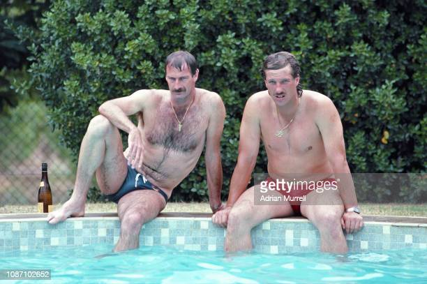 Dennis Lillee of Australia and Ian Botham of England relax by the swimming pool at Yalumba winery on the rest day of the Adelaide Test match between...