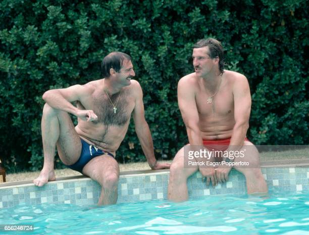 Dennis Lillee of Australia and Ian Botham of England relax by the swimming pool at the Yalumba winery on the rest day of the 3rd Test match between...