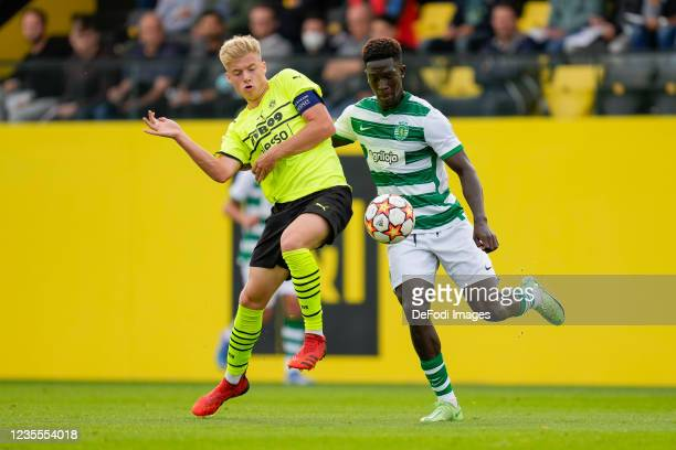 Dennis Luetke-Frie of Borussia Dortmund and Chico Lamba of Sporting CP battle for the ball n during the UEFA Youth League group C match between...
