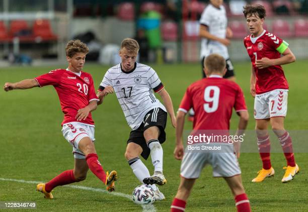 Dennis Luetke-Frie of Germany is challenged by players of Denmark during the International friendly match between U18 Germany and U18 Denmark on...