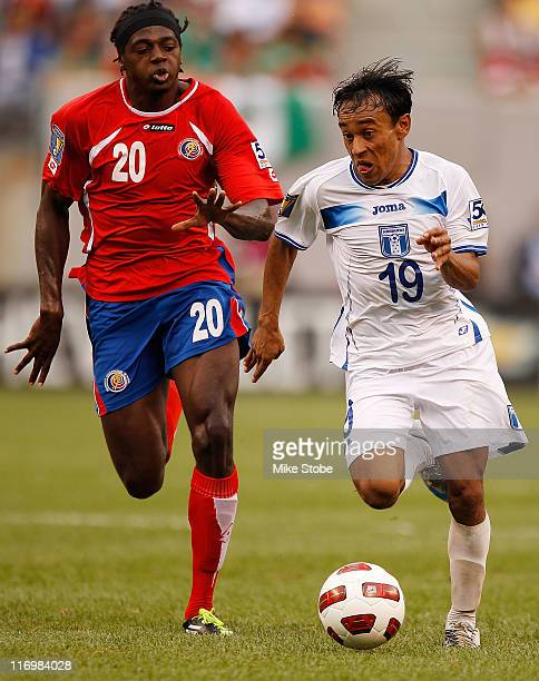 Dennis Marshall of Costa Rica and Javier Portillo of Honduras battle for possession during the 2011 Gold Cup Quarterfinals on June 18, 2011 at the...