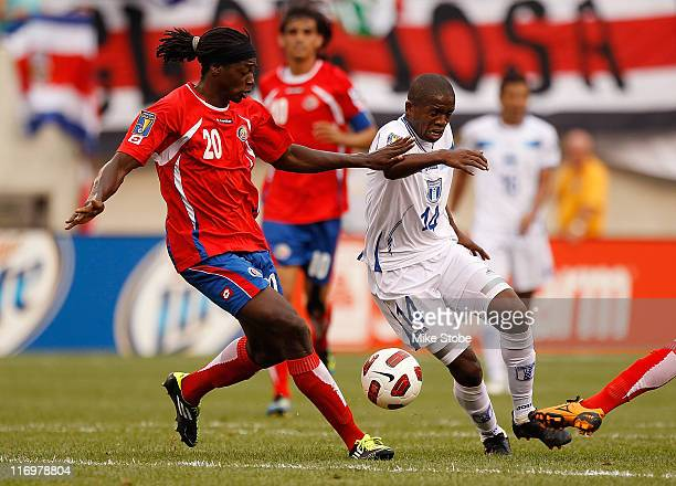 Dennis Marshall of Costa Rica and Oscar Boniek Garcia of Honduras battle for possession during the 2011 Gold Cup Quarterfinals on June 18, 2011 at...