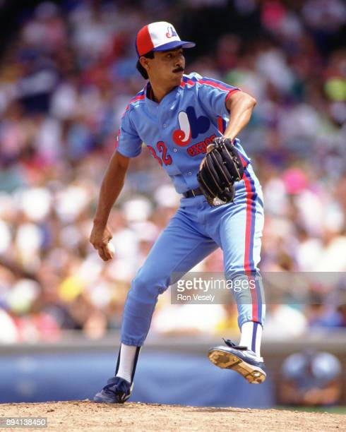 Dennis Martinez of the Montreal Expos pitches during an MLB game at Wrigley Field in Chicago Illinois during the 1990 season