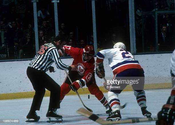Dennis Maruk of the Cleveland Barons takes the faceoff against Andre St Laurent of the New York Islanders on October 16 1976 at the Nassau Coliseum...