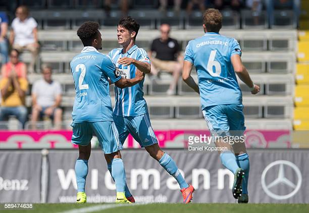 Dennis Mast of Chemnitz celebrates his team's first goal with team mates during the third league match between VfR Aalen and Chemnitzer FC at...