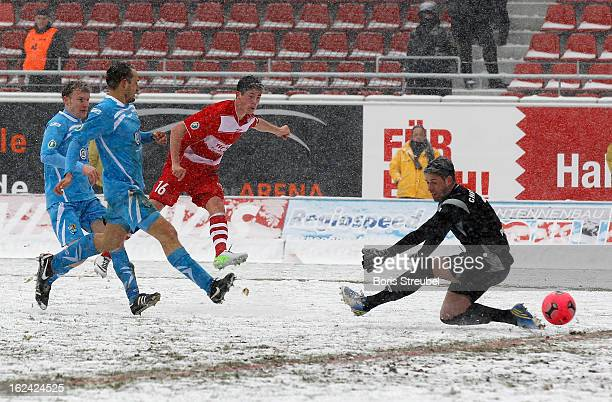 Dennis Mast of Halle scores his team's second goal during the Third League match between Hallescher FC and Chemnitzer FC at Erdgas Sportpark on...