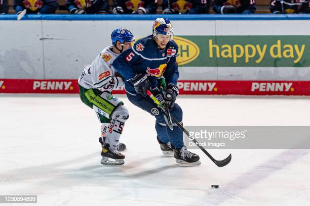Dennis Miller of Augsburger Panther and Keith Aulie of EHC Red Bull Muenchen battle for the puck during the DEL match between EHC Red Bull Muenchen...