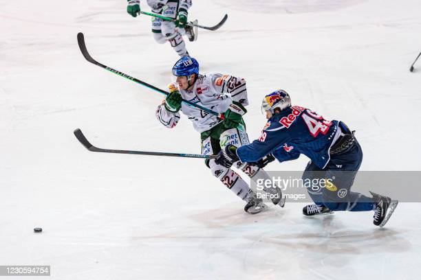 Dennis Miller of Augsburger Panther and Mark Voakes of EHC Red Bull Muenchen battle for the puck during the DEL match between EHC Red Bull Muenchen...