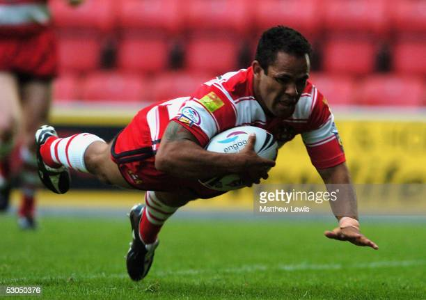 Dennis Moran of Wigan scores a try during the Engage Super League match between Wigan Warriors and Hull FC at the JJB Stadium on June 10 2005 in...