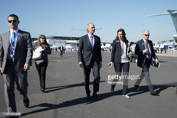 Dennis Muilenburg chief executive officer of Boeing Co center walks the tarmac during the 53rd International Paris Air Show at Le Bourget in Paris...