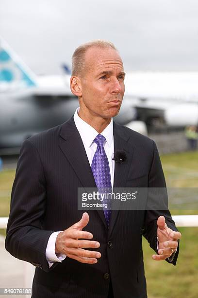 Dennis Muilenburg chief executive officer of Boeing Co gestures whilst speaking during a Bloomberg Television interview on the opening day of the...