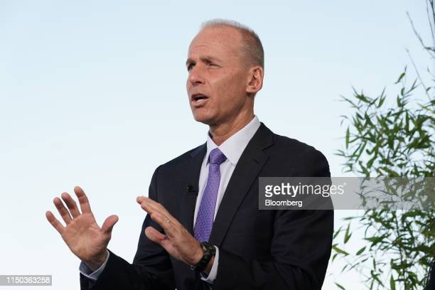 Dennis Muilenburg chief executive officer of Boeing Co gestures while speaking during a Bloomberg Television interview at the 53rd International...