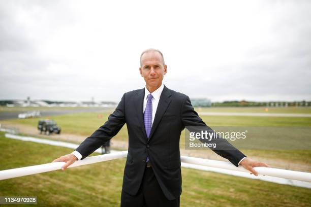 Dennis Muilenburg chief executive officer of Boeing Co poses for a photograph following a Bloomberg Television interview on the opening day of the...