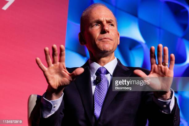 Dennis Muilenburg chief executive officer of the Boeing Co gestures during the US Chamber of Commerce Aviation Summit in Washington DC US on Thursday...