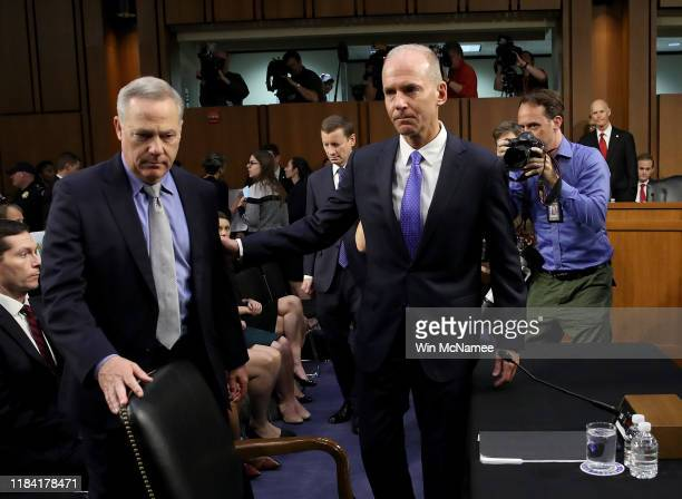 Dennis Muilenburg President and CEO of the Boeing Company and John Hamilton Vice President and Chief Engineer of Boeing Commercial Airplanes arrive...