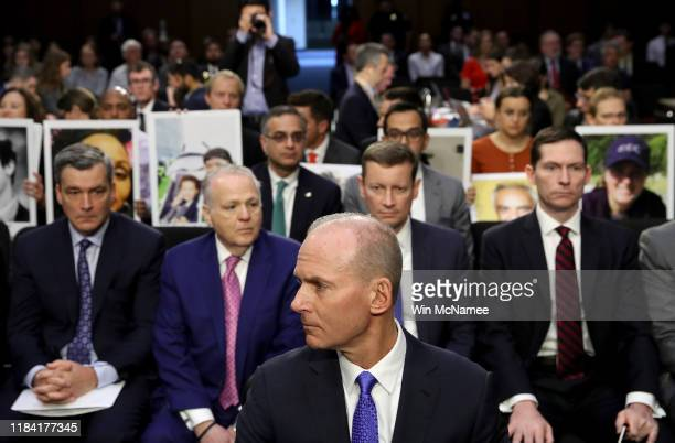 Dennis Muilenburg president and CEO of the Boeing Company sits at the witness table in front of family members of those who died aboard Ethiopian...