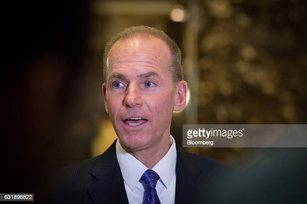 Dennis Muilenburg president and chief executive officer of The Boeing Co speaks with members of the media in the lobby of Trump Tower in New York US...
