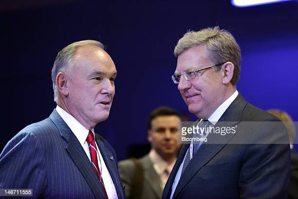 Dennis Nally chairman of Pricewaterhouse Coopers International Ltd left speaks with Alexi Kudrin former Russian finance minister ahead of a...