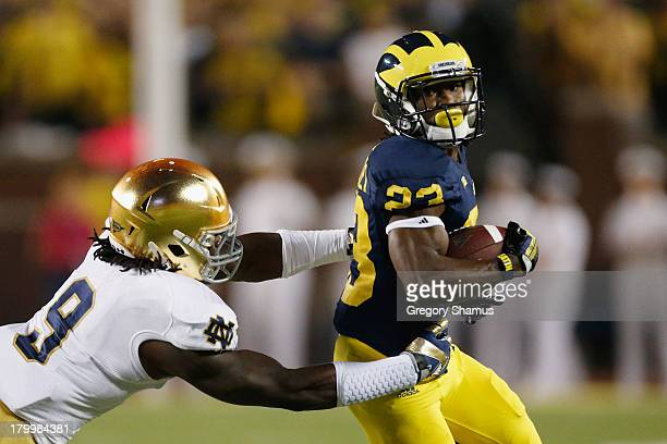 Dennis Norfleet of the Michigan Wolverines runs with the ball against the Notre Dame Fighting Irish during the game at Michigan Stadium on September...