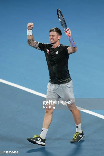Dennis Novak of Austria celebrates winning match point during his Group E singles match against Guido Pella of Argentina during day four of the 2020...