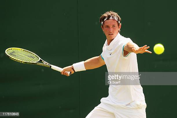 Dennis Novak of Austria in action during his first round boy's match against Thiago Moura Monteiro of Brazil on Day Seven of the Wimbledon Lawn...