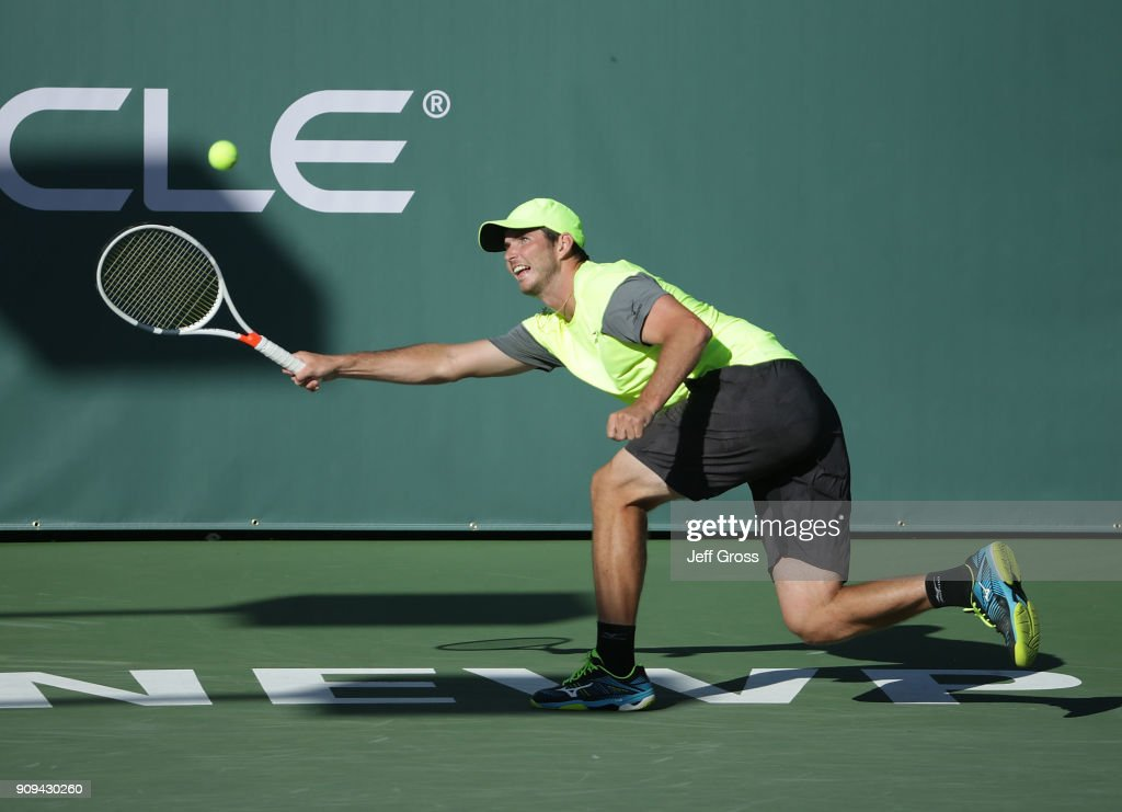 Dennis Novikov lunges to return a forehand to Kei Nishikori of Japan during the first round of the Oracle Challenger Series at the Newport Beach Tennis Club on January 23, 2018 in Newport Beach, California.
