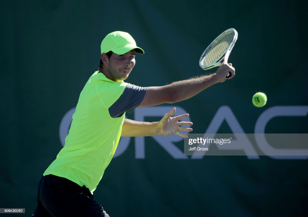 Dennis Novikov returns a backhand to Kei Nishikori of Japan during the first round of the Oracle Challenger Series at the Newport Beach Tennis Club on January 23, 2018 in Newport Beach, California.