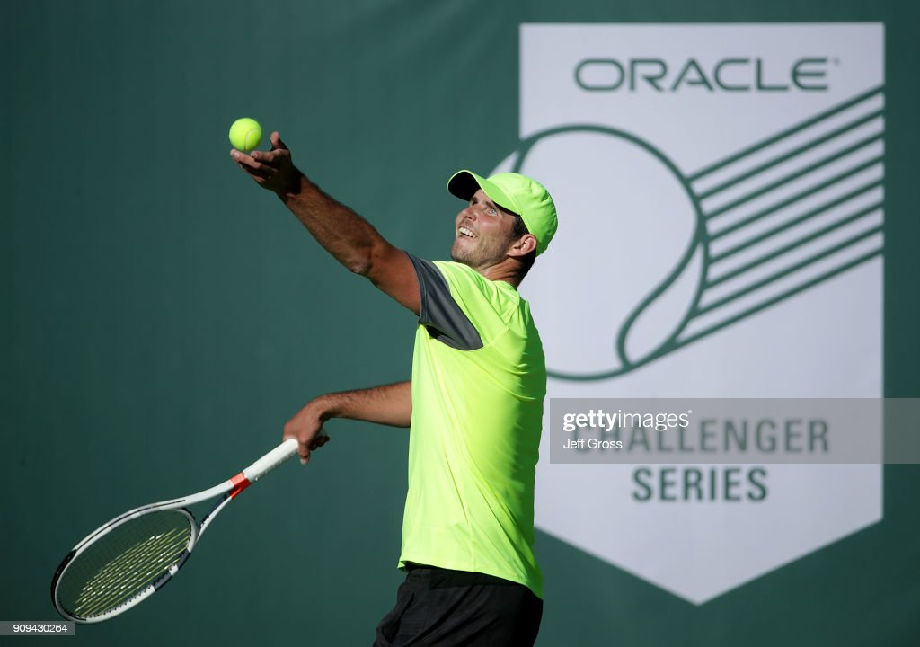 Dennis Novikov tosses the ball up before serving to Kei Nishikori of Japan during the first round of the Oracle Challenger Series at the Newport Beach Tennis Club on January 23, 2018 in Newport Beach, California.