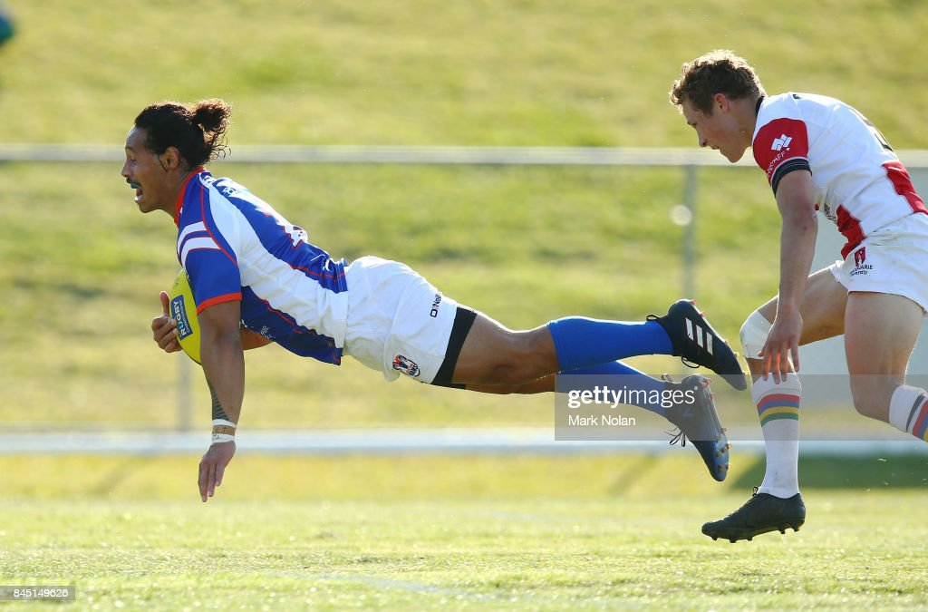 Dennis Pili-Gaitau of the Rams scores a try with team mates during the round two NRC match between the Rays and the Rams at Macquarie Uni on September 10, 2017 in Sydney, Australia.