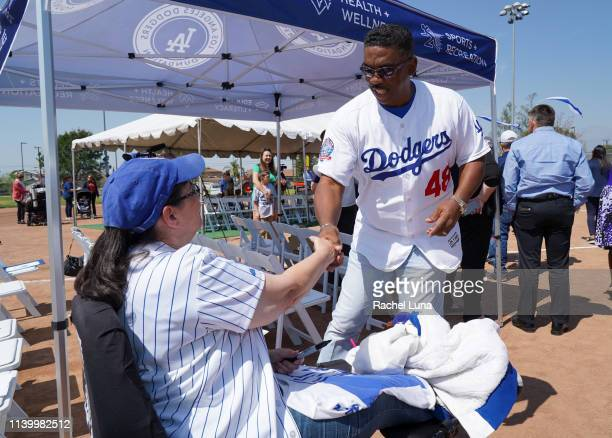 Dennis Powell greets fan Ruthee Goldkorn of Moreno Valley at the Los Angeles Dodgers Foundation groundbreaking ceremony of a universally accessible...