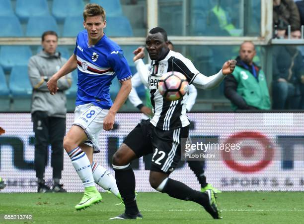 Dennis Praet and Kwadwo Asamoah during the Serie A match between UC Sampdoria and Juventus FC at Stadio Luigi Ferraris on March 19 2017 in Genoa Italy