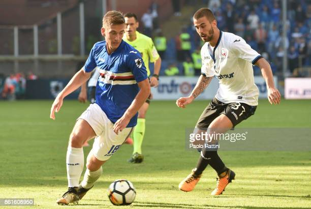 Dennis Praet and Leonardo Spinazzola during the Serie A match between UC Sampdoria and Atalanta BC at Stadio Luigi Ferraris on October 15 2017 in...