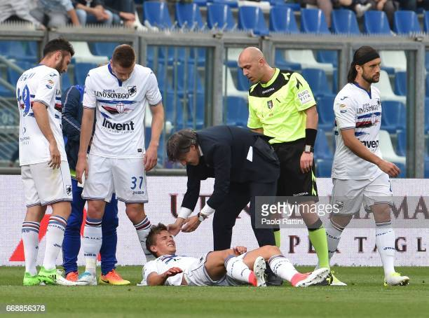 Dennis Praet injured during the Serie A match between US Sassuolo and UC Sampdoria at Mapei Stadium Citta' del Tricolore on April 15 2017 in Reggio...