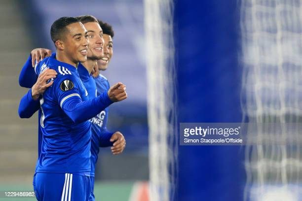 Dennis Praet of Leicester celebrates with teammates Youri Tielemans of Leicester and James Justin of Leicester after scoring their 3rd goal during...