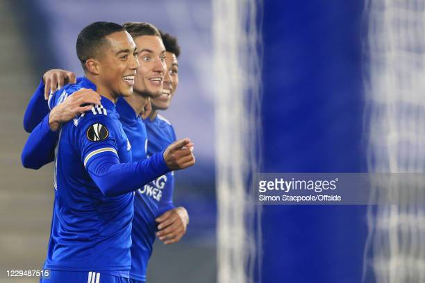 Dennis Praet of Leicester celebrates with teammates Youri Tielemans of Leicester and James Justin of Leicester after scoring their 2nd goal during...