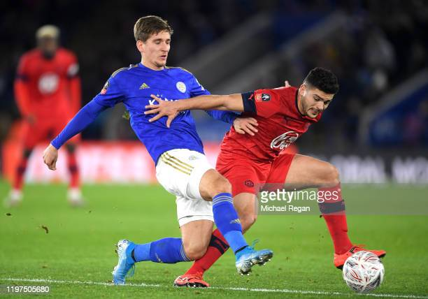 Dennis Praet of Leicester City battles for possession with Sam Sayed Morsy of Wigan Athletic during the FA Cup Third Round match between Leicester...