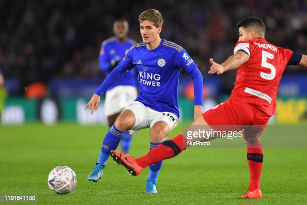 Dennis Praet of Leicester City battles with Sam Morsy of Wigan Athletic during the FA Cup Third Round match between Leicester City and Wigan Athletic...