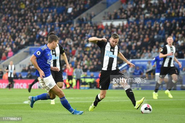 Dennis Praet of Leicester City shoots which deflects of Paul Dummett of Newcastle United for Leicester City's third goal during the Premier League...
