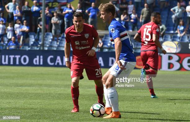 Dennis Praet of Sampdoria and Simone Padoin of Cagliari during the serie A match between UC Sampdoria and Cagliari Calcio at Stadio Luigi Ferraris on...
