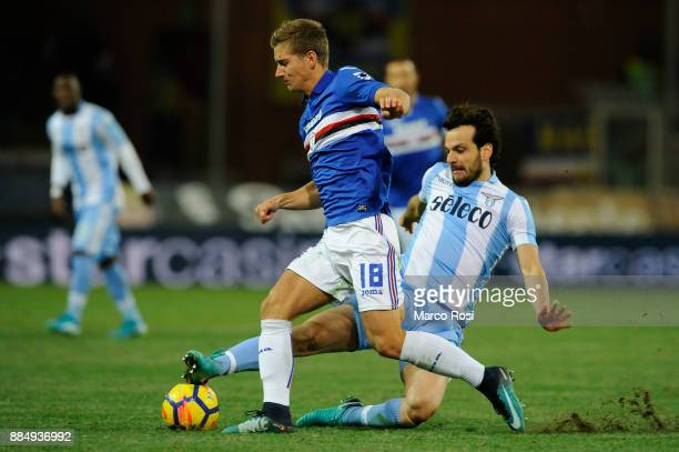 Dennis Praet of UC Sampdoria compete for the ball with Marco Parolo of SS Lazio during the Serie A match between UC Sampdoria and SS Lazio at Stadio...
