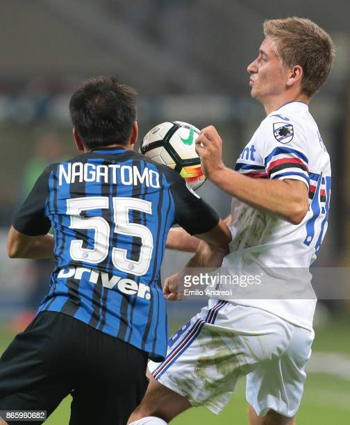 Dennis Praet of UC Sampdoria competes for the ball with Yuto Nagatomo of FC Internazionale Milano during the Serie A match between FC Internazionale...