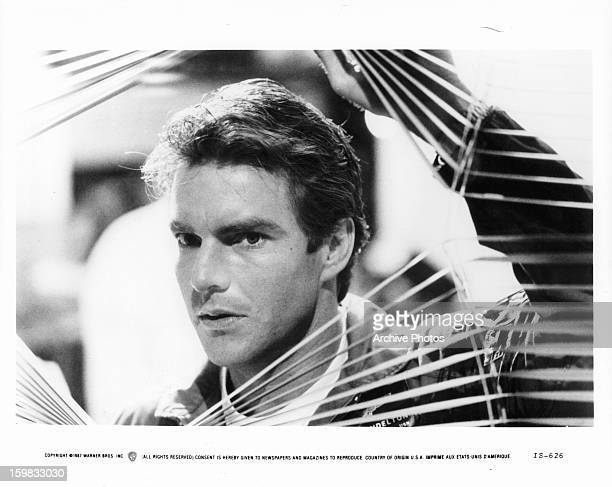 Dennis Quaid looks through window blinds in a scene from the film 'Innerspace' 1987