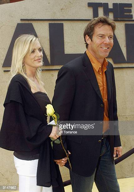 Dennis Quaid who plays Gen Sam Houston in The Alamo walks with Kimberly Buffington down the yellow carpet before the Disney premiere of the movie...