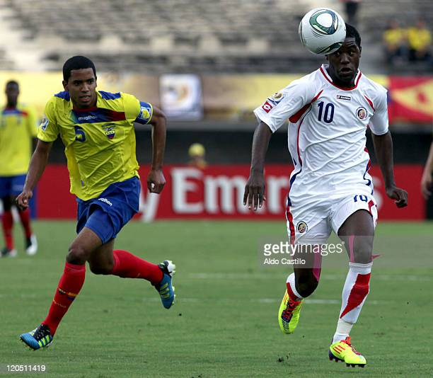 Dennis Quiñonez from Ecuador fights for the ball with Joel Campbell from Costa Rica during a match of Group C between Ecuador and Costa Rica as part...