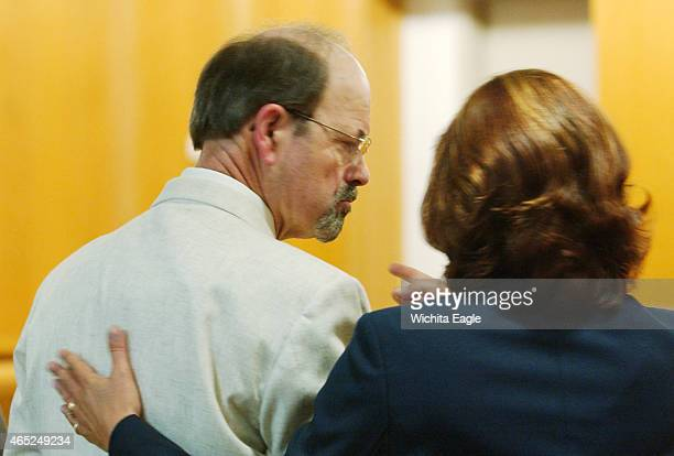 Dennis Rader consults with his lawyer Sarah McKinnon while entering his guilty pleas before Judge Gregory on June 27 admitting his guilt in 10...
