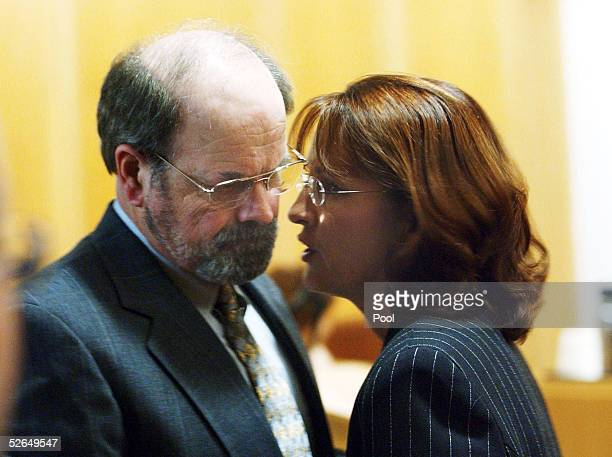 Dennis Rader suspected of being the BTK serial killer talks with one of his public defenders Sarah McKinnon after waving his preliminary hearing at...
