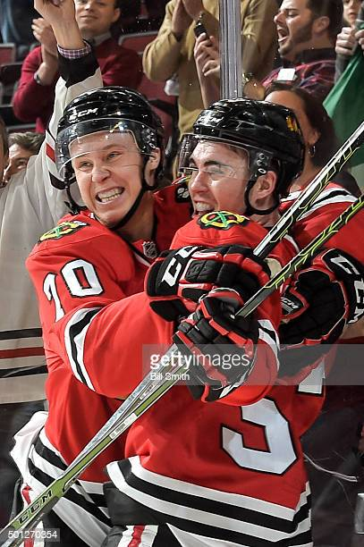 Dennis Rasmussen and Brandon Mashinter of the Chicago Blackhawks celebrate after Mashinter scored against the Vancouver Canucks in the third period...