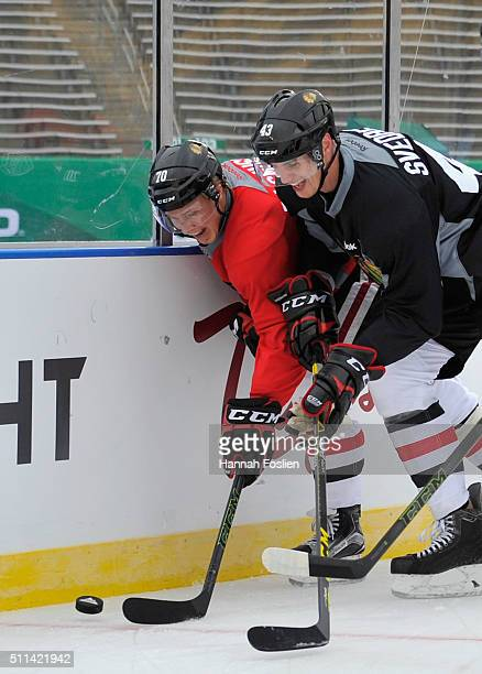 Dennis Rasmussen and Viktor Svedberg of the Chicago Blackhawks got after the puck during practice day at the 2016 Coors Light Stadium Series on...